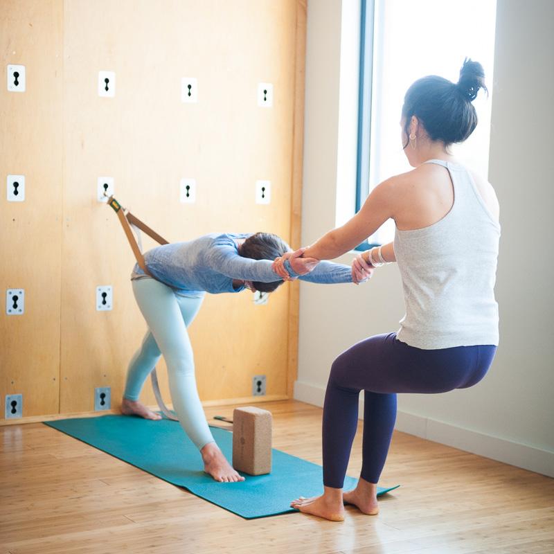 Partner Parsvottanasana | The Great Yoga Wall | Purna Yoga Asheville, NC