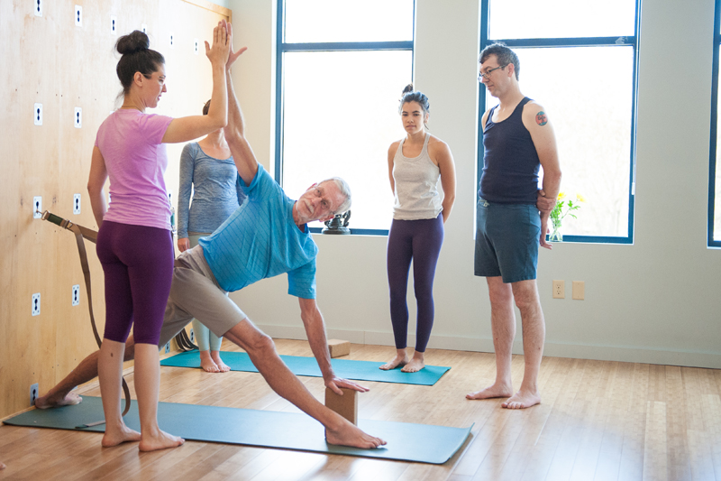 Parivrtta Trikonasana on Yoga Wall | Live Yoga Now